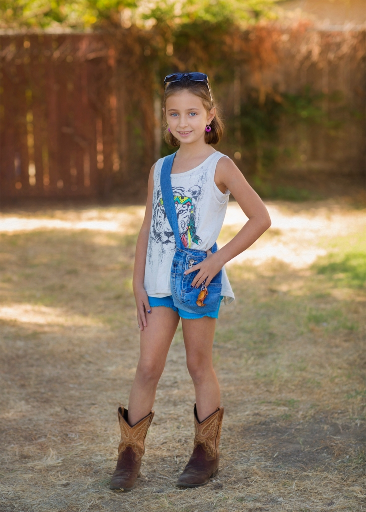 Isabella rocked her favorite outfit with sunglasses, earrings, purse and cowboy boots!